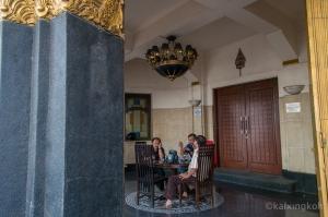 Locals around an Art Deco styled building